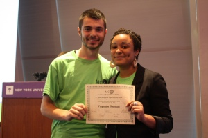 Perparim Kryeziu '10 receives a certificate for his participation in the MCW Leadership Something in Burlington, VT