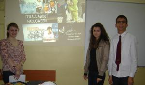 Bulgarian YES alumni Toma Pavlov '12 and Dyliana Nikolova '11 (both at right) give a presentation on Halloween to Fulbright teacher Kaitlen Whitt's class in Ruse