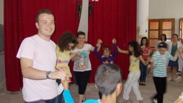 Arber dancing with the children at the orphanage.