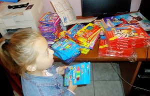 The alumni brought craft items like markers, colored pencils, and coloring books with them to give to the orphanage.