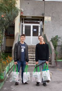 Nino and Etienne deliver books and supplies to the orphanage.