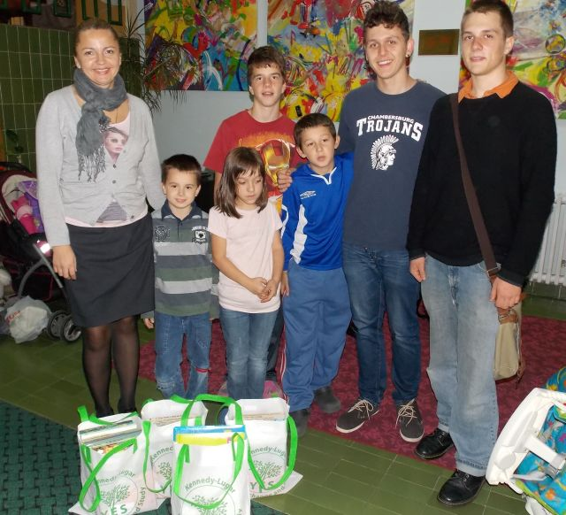 Staff and children of the Bjelave orphanage, along with Nino and Etienne and the donated books and supplies.
